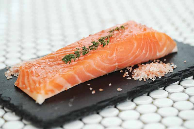 why is salmon expensive